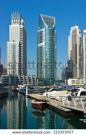 DUBAI, UAE - NOVEMBER 13: Yacht Club in Dubai Marina, on November 13, 2012, Dubai, UAE. In the city of artificial channel length of 3 kilometers along the Persian Gulf.