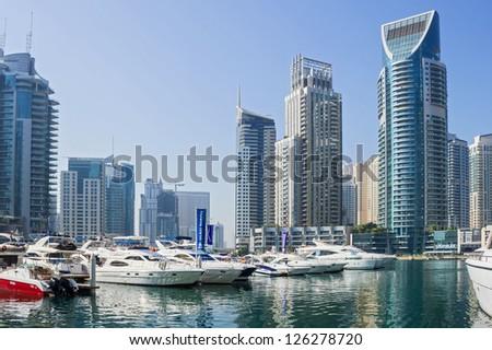 DUBAI, UAE - NOVEMBER 13: Yacht Club in Dubai Marina, on November 13, 2012, Dubai, UAE. In the city of artificial channel length of 3 kilometers along the Persian Gulf.