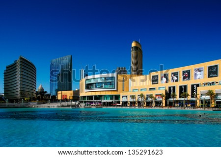 DUBAI, UAE - OCT 1: Dubai Mall and the Dubai Fountain on Oct 1, 2010 in Dubai, UAE. The Dubai Mall is the largest shopping mall in the world with some 1200 stores