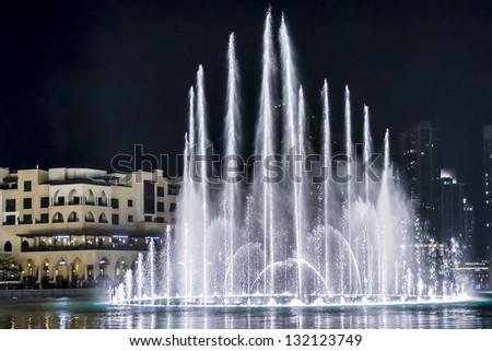 DUBAI, UAE - OCTOBER 1: A record-setting fountain system set on Burj Khalifa Lake - 6600 lights and 25 projectors, it shoots water 150 m into the air, at October 1, 2012 in Dubai, United Arab Emirate.
