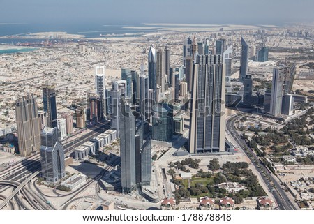 DUBAI, UAE. - OCTOBER 13, 2013 : Dubai, the top view on Dubai downtown from the tallest building in the world, Burj Khalifa, at 828m.