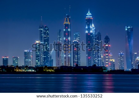 DUBAI, UAE - SEP 29: Night view of Dubai Marina from hotel Kempinski (Palm Jumeirah), on September 29, 2012 in Dubai, UAE. Dubai Marina - artificial canal city, carved along Persian Gulf shoreline.