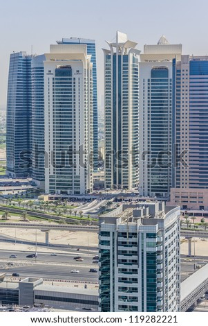DUBAI, UAE - SEPTEMBER 30: Al Seef Towers - 3 residential buildings in Jumeirah Lake Towers, on September 30, 2012 in Dubai, UAE. On November 18th 2012 a fire broke out at Tamweel Tower (on the left).