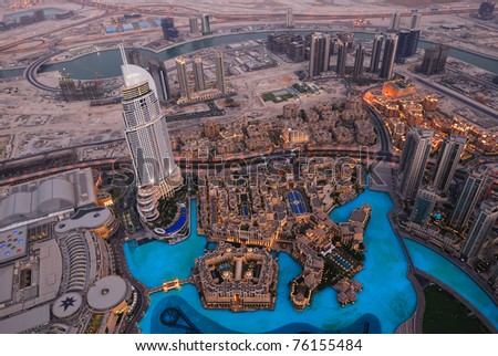 DUBAI, UAE - SEPTEMBER 1:  Evening view at downtown Dubai Address Hotel at September 1, 2010 in Dubai, UAE. The hotel is 63 stories high and feature 196 lavish rooms and 626 serviced residence - stock photo