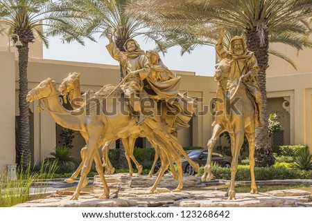 DUBAI, UAE - SEPTEMBER 30: Huge gold camels decorated entrance in 5 star hotel One&Only Royal Mirage (451 rooms, 65 acres of lush green lawns, 1 km beachfront), at September 30, 2012 in Dubai, UAE.