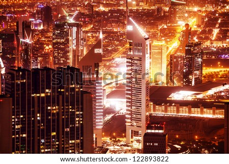 DUBAI, UAE - SEPTEMBER 27: Jumeirah Emirates Towers, which rise to 355 m and 309 m, located on the Sheikh Zayed Road, night scene on September 27, 2012 in Dubai, United Arab Emirates