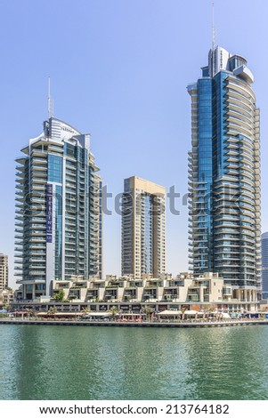 DUBAI, UAE - SEPTEMBER 29, 2012: Modern architecture in Dubai Marina - one of expensive township and most attractive tourist spot. Dubai Marina is an artificial canal city along Persian Gulf shoreline
