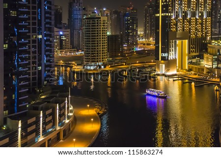 DUBAI, UAE - SEPTEMBER 29: Night view at modern skyscrapers in Dubai Marina on September 29, 2012 in Dubai, UAE. Dubai Marina - artificial canal city, carved along a stretch of Persian Gulf shoreline.