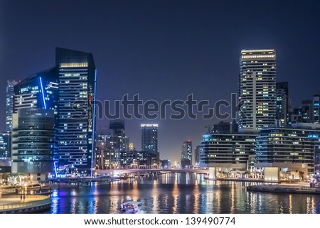 DUBAI, UAE - SEPTEMBER 29: Night view at modern skyscrapers in Dubai Marina on September 29, 2012 in Dubai, UAE. Marina - artificial canal city, carved along a 3 km stretch of Persian Gulf shoreline.