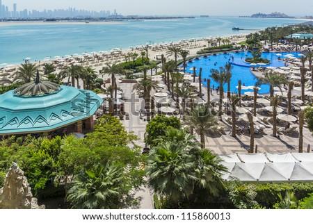 DUBAI, UAE - SEPTEMBER 30: 5-star Hotel Atlantis (1,539 spacious guest rooms including 166 suites) on man-made island of Palm Jumeirah at September 30, 2012 in Dubai, United Arab Emirates. Pool, Beach