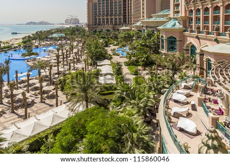 DUBAI, UAE - SEPTEMBER 30: 5-star Hotel Atlantis (1,539 spacious guest rooms including 166 suites) on man-made island of Palm Jumeirah at September 30, 2012 in Dubai, United Arab Emirates. Pool, Beach