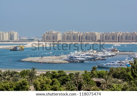 DUBAI, UAE - SEPTEMBER 29: View at Dubai Marina and man-made island of Palm Jumeirah on September 29, 2012 in Dubai, UAE. Dubai Marina - artificial canal city, carved along Persian Gulf shoreline.