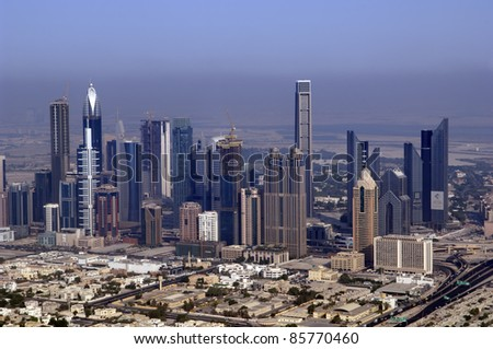DUBAI, UAE - SEPTEMBER 26: View at Sheikh Zayed Road skyscrapers in Dubai at September 26, 2011. More than 25 skyscrapers taller than 100 meters can be found there.