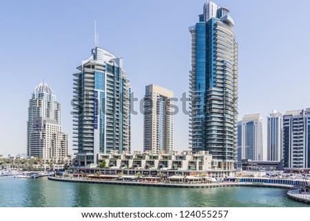 DUBAI, UAE - SEPTEMBER 29: View of modern skyscrapers in Dubai Marina on September 29, 2012 in Dubai, UAE. Dubai Marina - artificial canal city, carved along a 3 km stretch of Persian Gulf shoreline.
