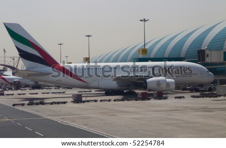 DUBAI, UNITED ARAB EMIRATES - APRIL 27: Emirates Airlines Airbus A380 docked at Dubai International Airport on April 27, 2010 in Dubai, UAE. Emirates was first customer to place order for the a380.
