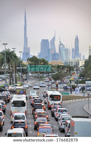 DUBAI, UNITED ARAB EMIRATES - FEBRUARY 9, 2014: Traffic on highway  to the city center. During rush hour all highways  are full with traffic. February 9, 2014 Dubai, United Arab Emirates