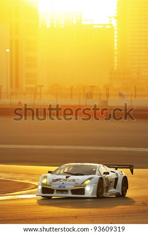 DUBAI, UNITED ARAB EMIRATES- JANUARY 14: Lamborghini Gallardo racing car in action at sunset  during the Dunlop 24Hr Dubai Race on Jan. 14, 2011 in Dubai, United Arab Emirates.
