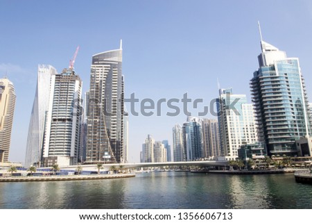 Dubai, United Arab Emirates - January 07, 2019 : Modern beautiful architecture commercial hotels and residential buildings at morning with blue sky in City of Dubai. #1356606713