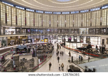 DUBAI, UNITED ARAB EMIRATES - JANUARY 8: The Dubai Mall. The greatest Mall in Dubai. Many people walking between shops and restaurants in January 8, 2013 during sales period.