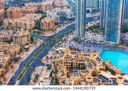 Dubai, United Arab Emirates - July 5, 2019: Dubai downtown streets and residential buildings top view #1444180739
