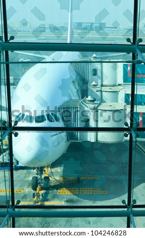 DUBAI, UNITED ARAB EMIRATES - JUNE 2: Emirates Airlines Airbus A380 docked at Dubai International Airport on June 2, 2012 in Dubai, UAE. Emirates was first customer to place order for the a380.