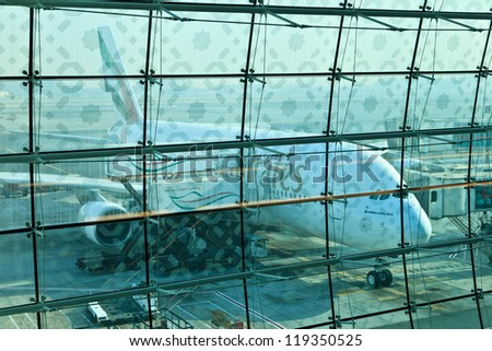 DUBAI, UNITED ARAB EMIRATES - NOVEMBER 10: Emirates Airlines Airbus A380 docked at Dubai Airport on November 10, 2012 in Dubai, UAE. Emirates was first customer to place order for the a380.