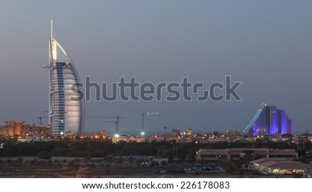 Dubai, United Arab Emirates - October 8, 2014: A night shot of Dubai\'s most well known landmarks : The Burj Al Arab and Jumeraih Beach Hotel.