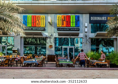 DUBAI, UNITED ARAB EMIRATES - SEPTEMBER 8, 2015: View restaurant in Dubai Marina. Marina - artificial canal city, there are a lot of restaurants, bars, cafes and shops.