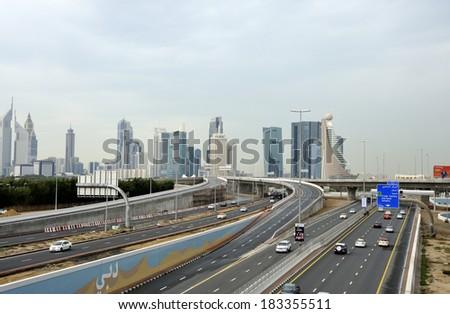 DUBAI UNITED EMIRATES - FEBRUARY 9, 2014: Traffic on highway Sheikh Zayed Road leading to the city center. February 9, 2014 Dubai, United Arab Emirates