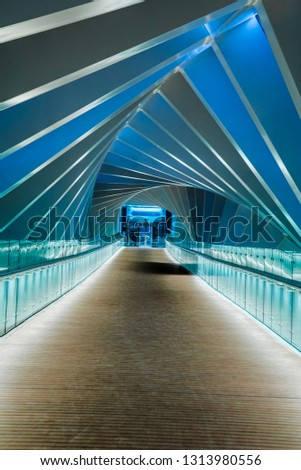 Dubai Water Canal, Dubai, United Arab Emirates - November 16, 2018: Walk on the Magnificent Abstract Spiral perspective architecture Bridge in Dubai Water Canal- Image #1313980556
