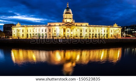 Dublin Custom House at night with reflection in the river Liffey