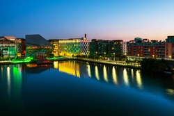 Dublin, Ireland. Aerial view of Grand Canal docks in Dublin, Ireland at sunrise. Empty streets and illuminated modern buildings, colorful clear sky