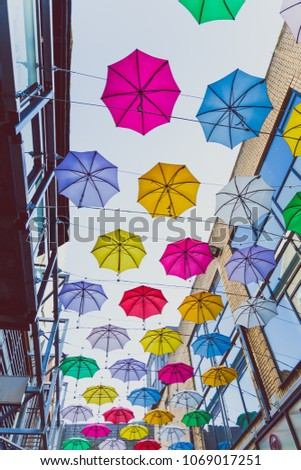 DUBLIN, IRELAND - April 14th, 2018: colorful umbrellas art installation in frot of the Zozimus bar in Dublin city centre