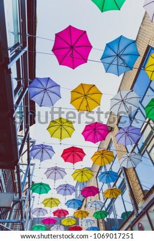 DUBLIN, IRELAND - April 14th, 2018: colorful umbrellas art installation in frot of the Zozimus bar in Dublin city centre