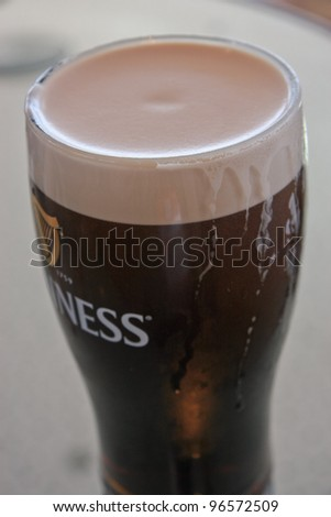 DUBLIN, IRELAND - JUNE 19, 2008: Pint of beer served at Guinness Brewery on June 19, 2008 in Dublin. Brewery where 2.5 million pints of stout are brewed daily was founded by Arthur Guinness in 1759