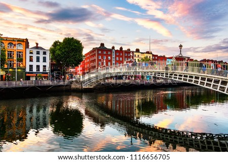 Dublin, Ireland. Night view of famous illuminated Ha Penny Bridge in Dublin, Ireland at sunset