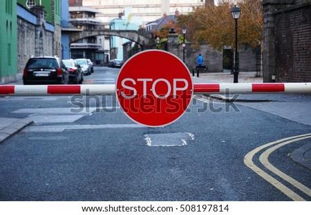 DUBLIN, IRELAND -1 NOV 2016- A red stop sign on a barrier blocks the entrance to the Dublin Castle. #508197814