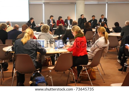 DUBLIN - JUNE 11: People sit at the discussion tables in the meeting hall on CEPIC Congress 2010 on June 11, 2010 in Dublin. CEPIC is a center of Picture Industry