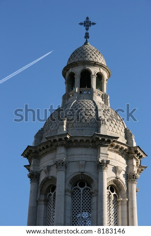 Dublin Landmark - ornate tower next to Trinity College wit an airplane in the background