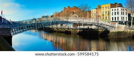 Dublin, panoramic image of Half penny bridge, or Ha'penny bridge, on a bright day #599584175