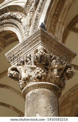 DUBROVNIK, CROATIA - APR 26, 2019 - Figures on capitals of the Rector's Palace, Dubrovnik, Croatia #1450583216