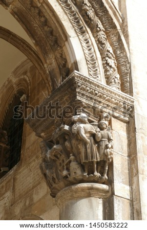 DUBROVNIK, CROATIA - APR 26, 2019 - Figures on capitals of the Rector's Palace, Dubrovnik, Croatia #1450583222