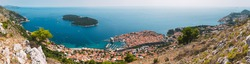 Dubrovnik Old Town and the Lokrum island on the Adriatic Sea in Croatia, aerial view, Panorama