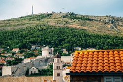 Dubrovnik old town medieval city walls and mountain in Croatia