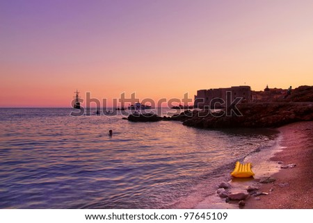 Dubrovnik old town pier and Banje beach at sunset