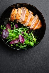 duck breast fried and salad leaves portion grill or barbecue roasted meat poultry on the table meal snack keto or paleo diet outdoor top view copy space for text food background rustic image
