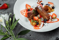 Duck breast with strawberry sauce.bon appetit. fine dining.Duck breast, strawberry sauce, apple salsa with cinnamon, seasonal berries. top food background. copy space