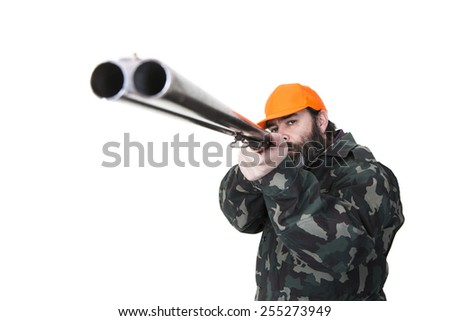 Duck hunter with orange safety hat aiming a double barreled shotgun on a white background