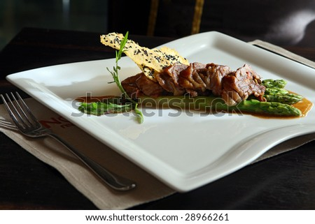 Duck stuffed vegetable by under cognac sauce with an asparagus