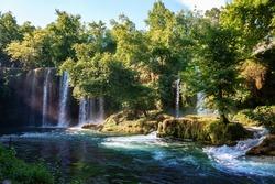 Duden waterfall Antalya Turkey. Summer wild nature with green trees. Panoramic view on Duden Waterfall. Outdoor forest waterfall. Turkey nature landscape. Waterfall forest nature. Antalya natural park